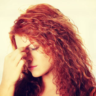 woman suffering from rhinosinusitis symptoms